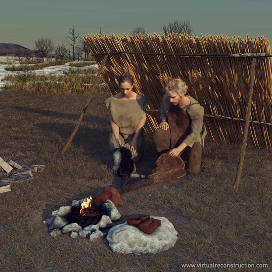 Reconstructed scene: Iron age smith with the help of his wife pumps air into the furnace to get the necessary temperature to melt the iron.