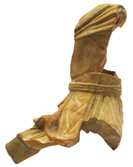 The broken piece of the Mithras statuette.